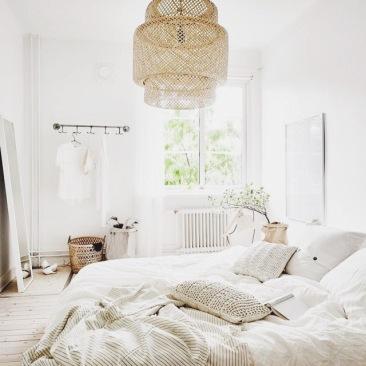 Peaceful bedroom with wicker light fixture
