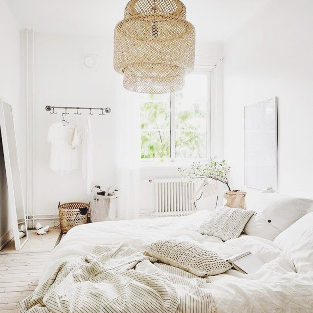 Peaceful bedroom with wicker light fixture