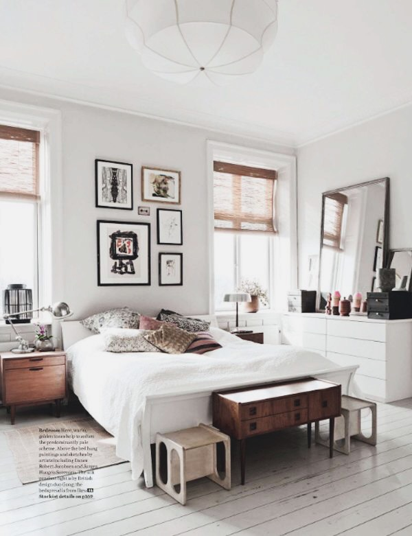 Bedroom with whitewashed floor