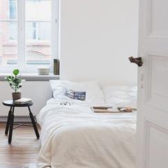Bedroom peek with stool as nightstand