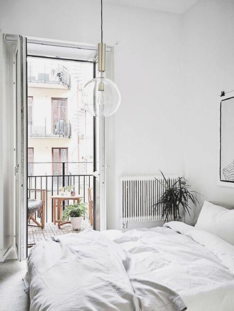 minimalistic bedroom with juliet balcony