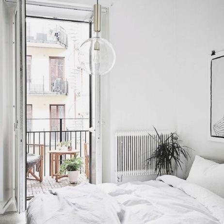 minimalistic bedroom with juliet balcony