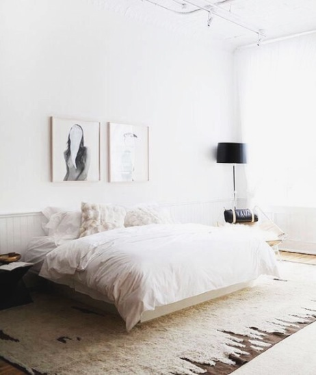 Simple bedroom with striking art